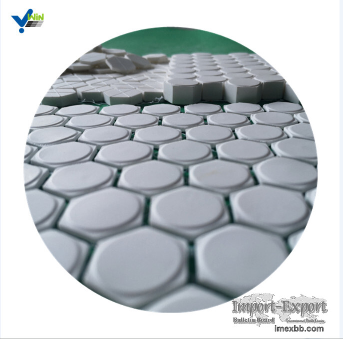 Wear resistant carbon steel pipe with alumina tile